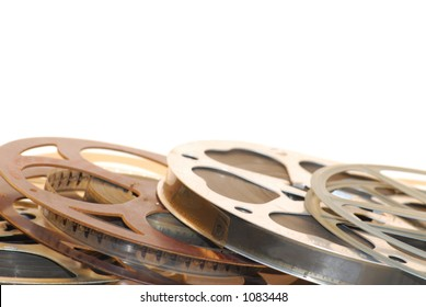 Close up view of film reels - metal and plastic with film on them.