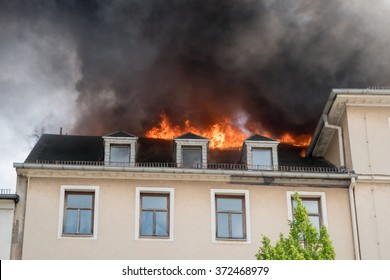 Close view of flames in an upper story window