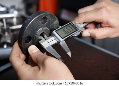 Close up view of flange internal diameter measurement with digital vernier caliper micrometer. A micrometer, sometimes known as a micrometer screw gauge, is a device incorporating a calibrated screw.
