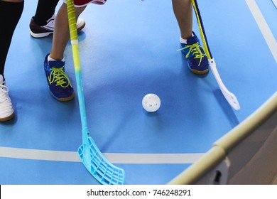 Close view of floorball players during mach next to the plastic mantinel