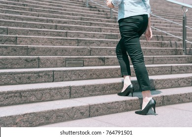 close up view of foot leg high heels woman walking up on the stair, business promotion concept.