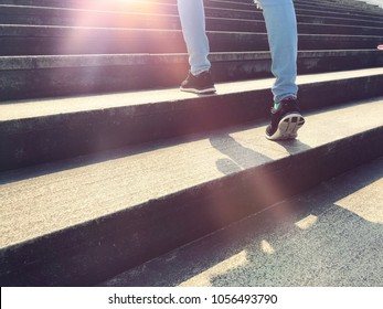 Close up view of foot leg sport women walking up on the stair, business promotion concept, business successful