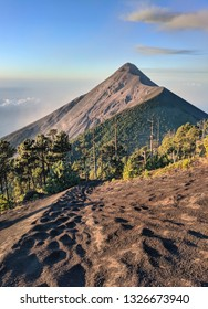 Close view of Fuego volcano early in the morning, volcanic ash in the foreground. Guatemala, Central America.