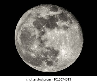 A close up view of a full Moon, in black and white.