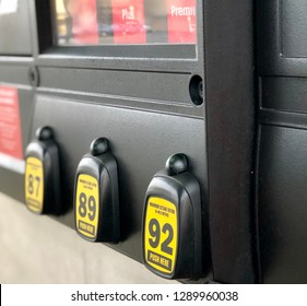 Close up view of gas station pump with various octane levels of gasoline for purchase