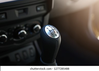 Close up view of a gear lever shift. Manual gearbox. Car interior details. Car transmission. Soft lighting.