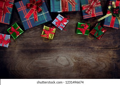 close up view  of gifts boxes  on wooden back