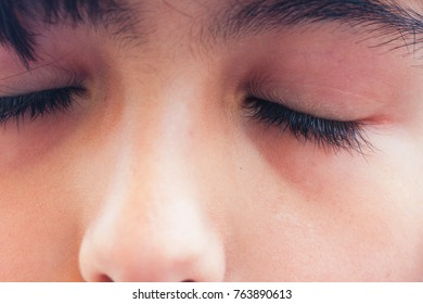 Close up view of girl with eyes closed