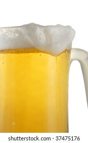 Close up view of glass of beer with foam flowing over the side.