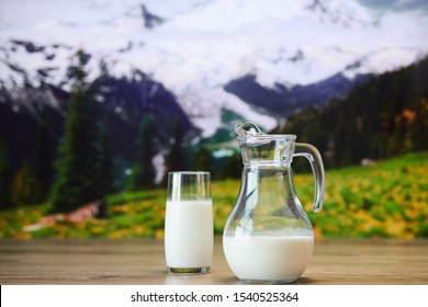 Close up view of glass of milk on the background of nature.