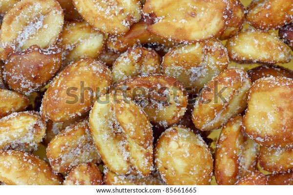 A close view of glazed toasted peanuts.