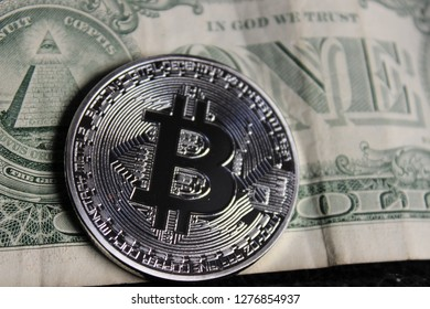 Close up view of gold and silver bitcoin with different background