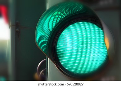 Close up view of green color on the traffic light.