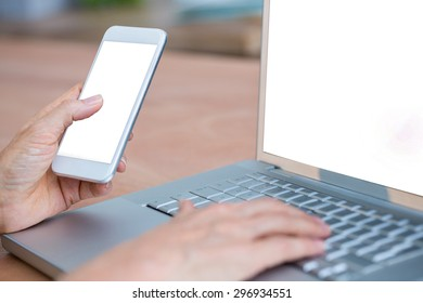 Close up view of hands typing on laptop and texting