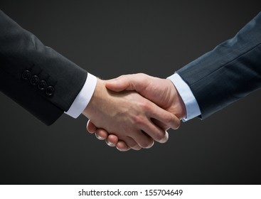 Close up view of handshake of business people. Concept of trustworthy relations and business cooperation