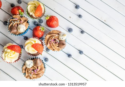 Close up view of home made cupcakes on wooden table. Selective focus.