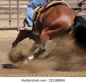 A close up view of a horse kicking up dirt in a competition race.
