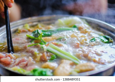 Close up view of hotpot with meat beef sliced and vegetables. Shabu Shabu is style beef in hotpot dish of thinly sliced meat and vegetables boiled in water. delicious food most popular in Thailand.