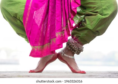 Close up view Indian Classical odssi Dance feet with Traditional ankle bells called ghungru , Alta(Red Dye)