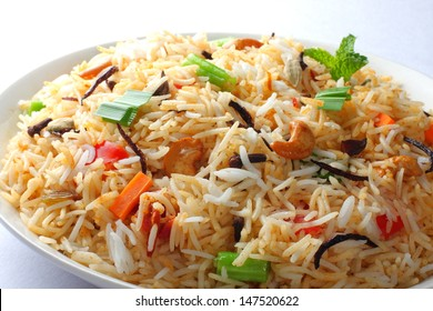 Close up view of The Indian Pulav- It is a medley of rice, vegetables and/or meat. The Basmati  rice is browned in oil and then mixed with vegetables, egg, chicken , nuts, fruits etc.