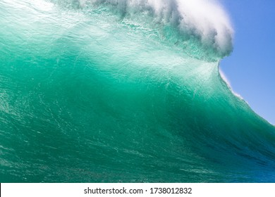 close up view inside a barrelling wave