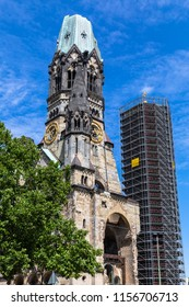 Close view of the Kaiser Wilhelm Memorial Church in Berlin on a sunny summer day, a famous landmark in western Berlin, Germany. With the modern belfry in renovation.