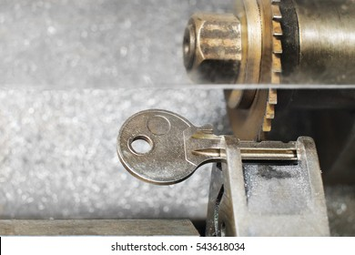 Close view of key copying machine with key.