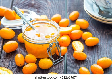 Close Up View of Kumquat Jam in Glass Jar on Dark Wooden Table, Horizontal View