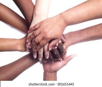 A close up view of a large group of people of mixed races and genders holding hands in a supportive manner.