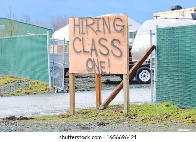 Close view of a large hand written English sign looking for industrial Class One Tradesmen.
