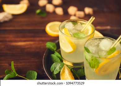 Close up view of lemonade in glass. Preparing of lemonade. ingredients for lemonade on rustic wooden table
