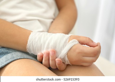 Close up view of little girl's wrist with applied bandage