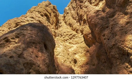 a close up view looking vertically up a cathedral termite mound in the northern territory of australia