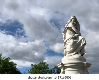 Close view of Lorelei Fountain (also known as the Heinrich Heine Memorial) in Joyce Kilmer Park on a spring day against cloudy blue sky in The Bronx, New York