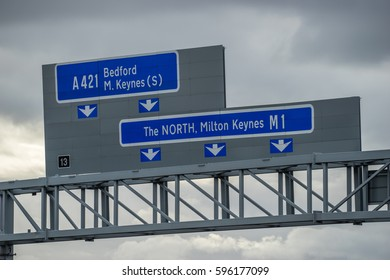 Close up view of M1 highway signs against dark sky