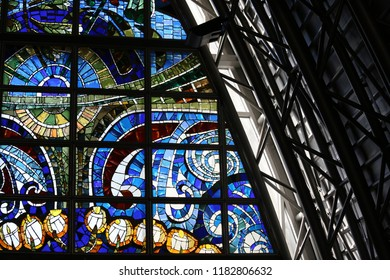 Close up view of the major stain glass called la creation, located in the saints françois church, carnot place, montpellier city, France. September, 16, 2018. Colorful image with curved shapes.
