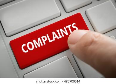 Close view of male hand touching the complaints button. complaints concept.