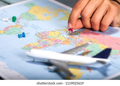 Close up view of man or woman pointing at places on world map. Travel concept backgroundad.