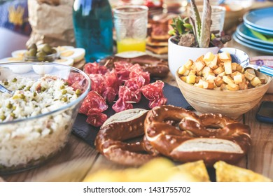 Close up view of many foods on a wooden table. Viande multicolor ready for a party. Apetizing colorful buffet. Summer aperitif, joy and family holidays, dinner on the terrace. Light lunch to share.