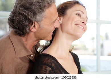 Close up view of a mature couple being affectionate at home.