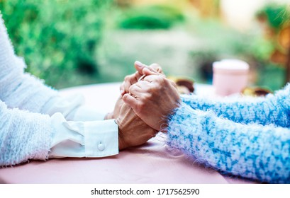 Close up view of mature couple holding hands, loving caring elderly man supporting senior middle aged woman giving psychological empathy and understanding in marriage, getting older together concept.