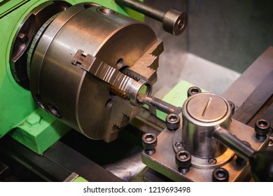 Close view of a metal lathe at work