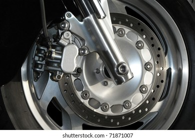Close up view of a modern motorcycle wheel.