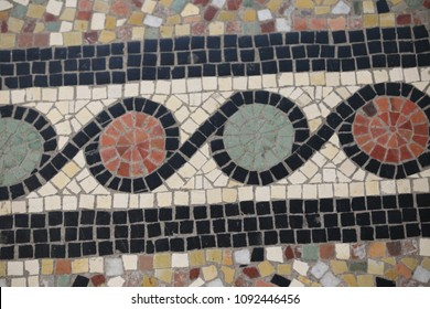Close up view of a mosaic floor in notre dame de brebière basilica, located in albert city, France. May, 9, 2018. Colorful surface with lines and circular shapes. Pattern of geometric drawings.