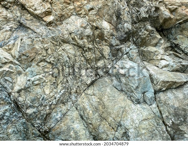 a close up view of mountain rock formation granite slate stone pattern