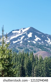 Close up view of Mt Bachelor in the summer in Bend Oregon on a sunny day. Snow still on the mountain