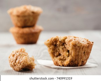 Close up view of muffin with zucchini, carrots, apple and cinnamon on gray wooden background. Sweet vegetables homemade muffins. Toddler-friendly recipe idea. Copy space. Shallow DOF