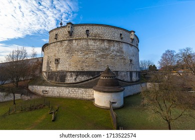 Close up view of Munot fortification from backyard with green grass surrounded by vineyard in center of Schaffhausen city center on sunny day in autumn with blue sky cloud in background, Switzerland