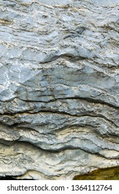 Close up view of natural wavy rochy formation. Abstract rough design