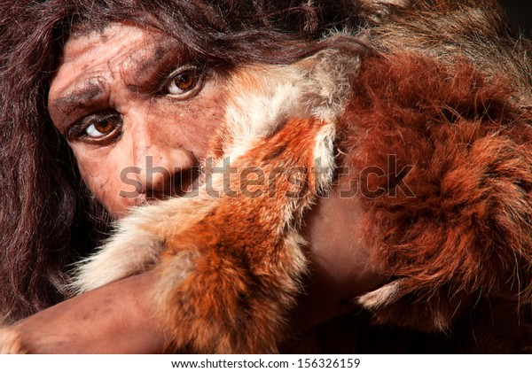 close view of a neanderthal man, focused in eyes expression